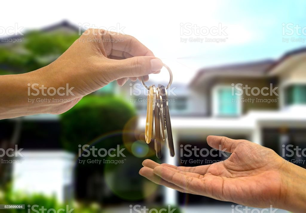 Purchasing  property with two hands and key stock photo
