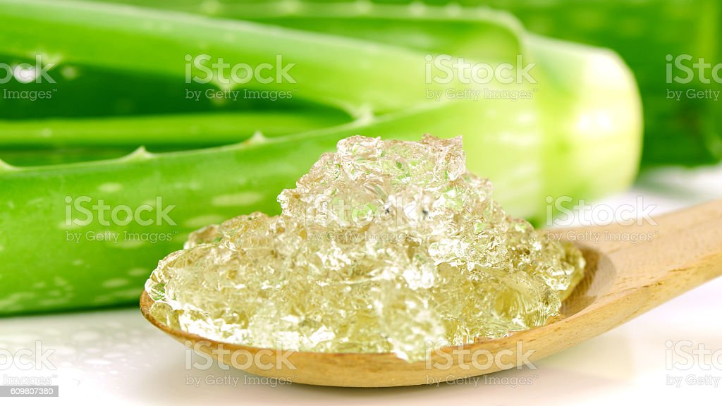 Pure Aloe Vera Gel on Wooden Spoon. stock photo