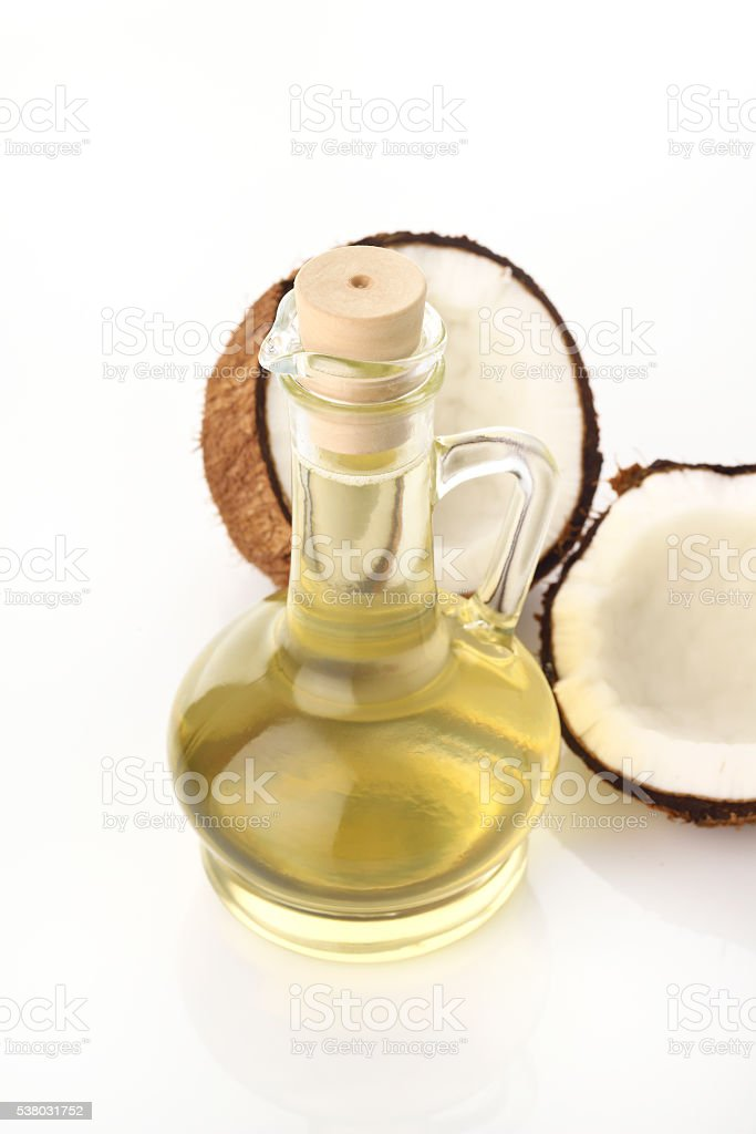 Pure Coconut Oil with Coconuts on White Background stock photo