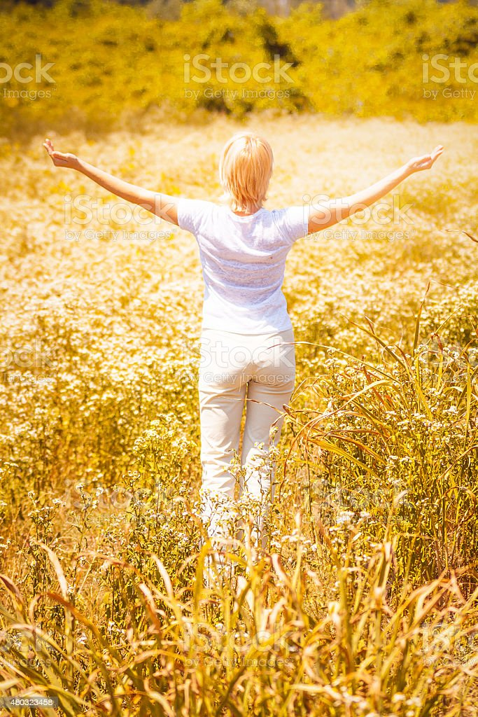 Pure, Natural, Beautiful Woman In a meadow stock photo