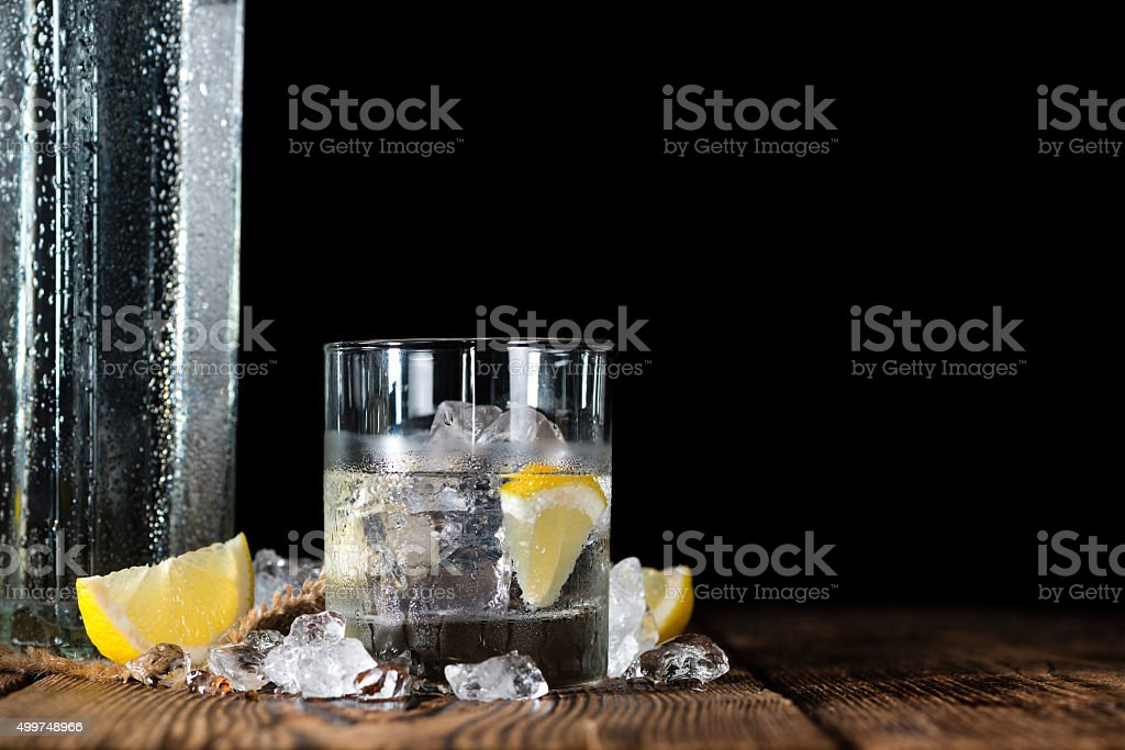 Pure Vodka (on an old wooden table) stock photo