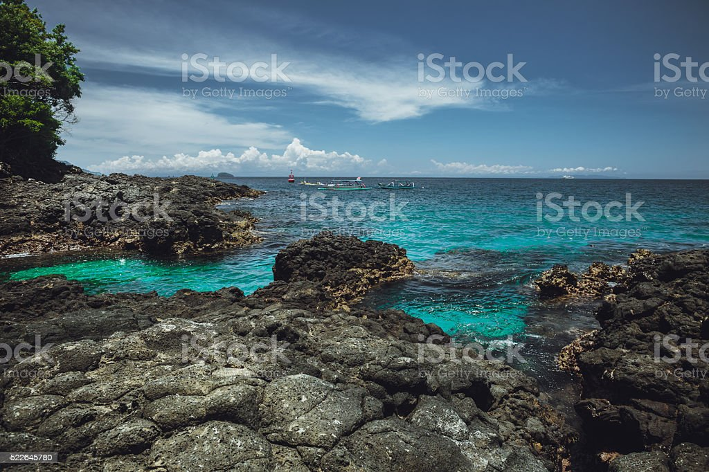 Pure water of ocean and rocks. Bali stock photo