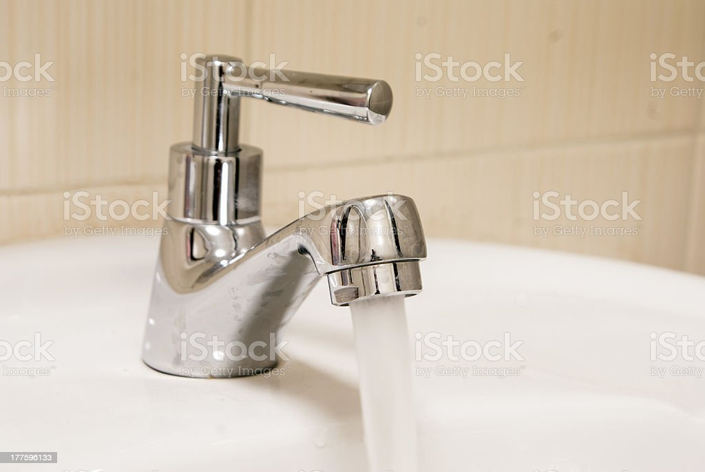 pure water running down from the faucet royalty-free stock photo