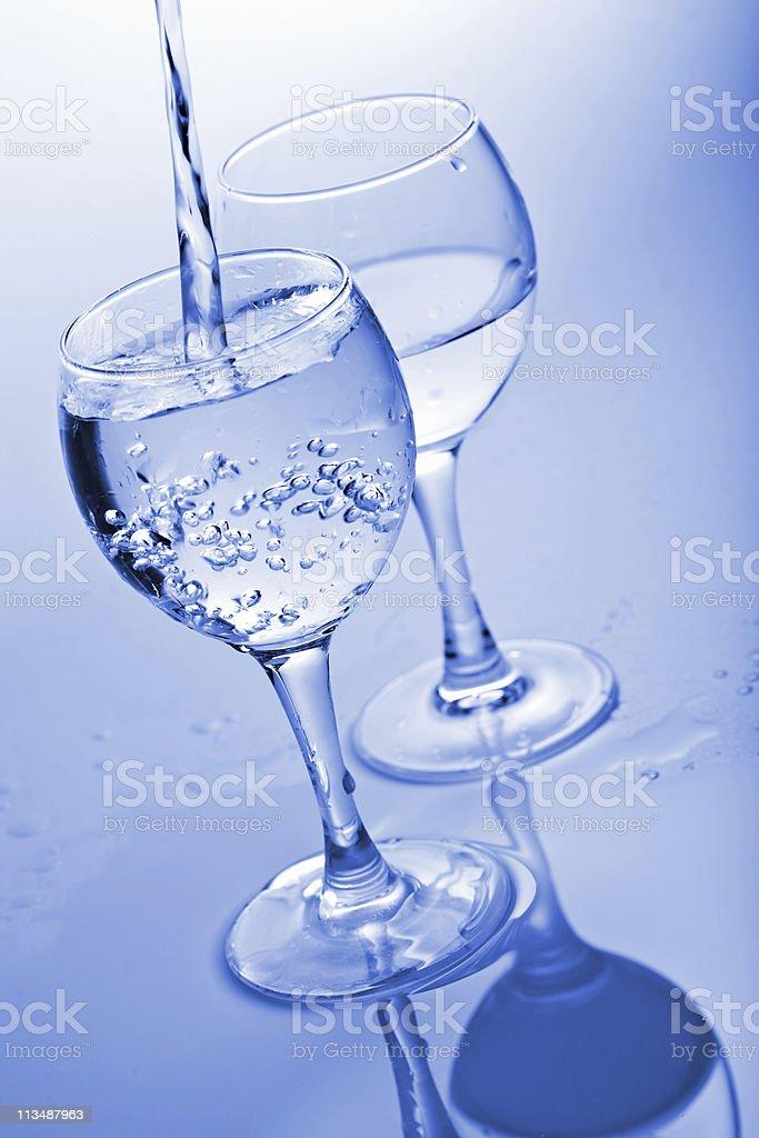 pure water splashing into glass royalty-free stock photo