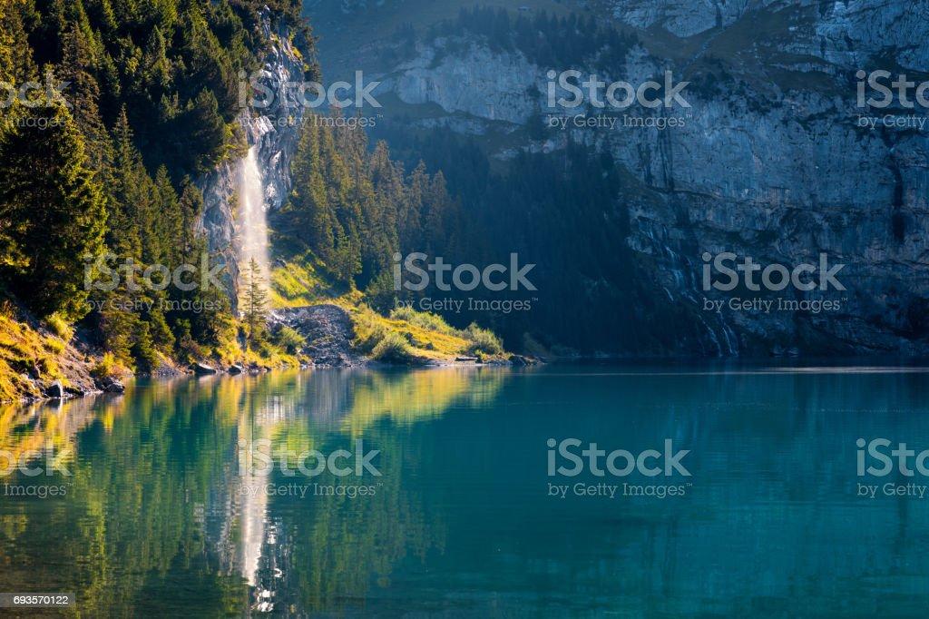 Pure water watterfall on unique lake - Oeschinen (Oeschinensee) stock photo