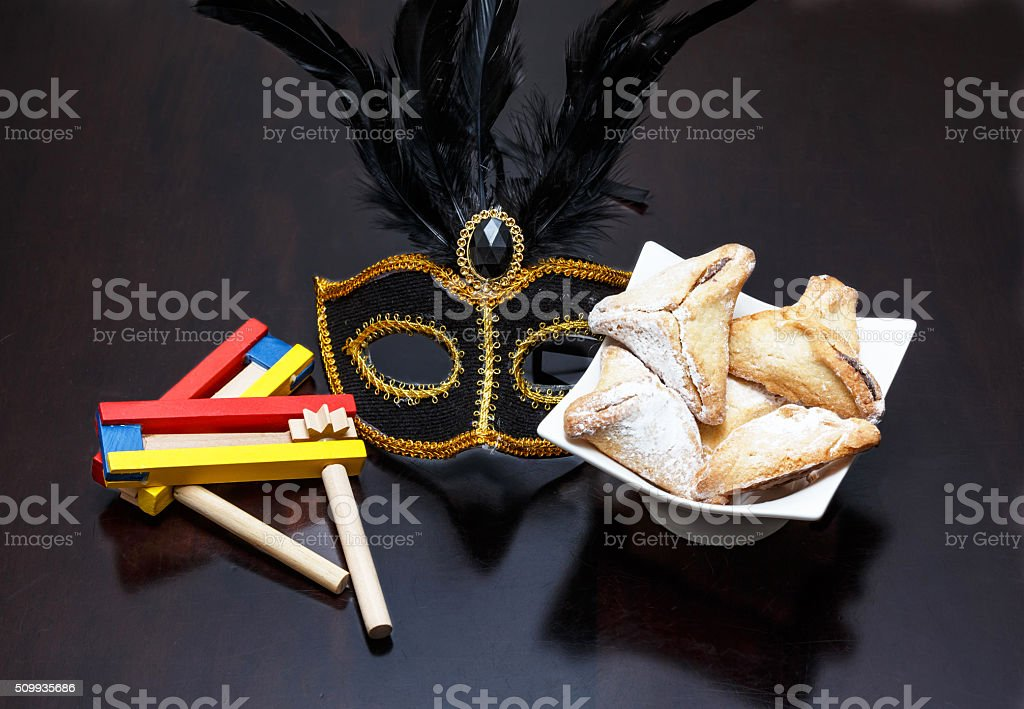 Purim holiday cookies, Colorful noisemaker, and Purim Mask stock photo