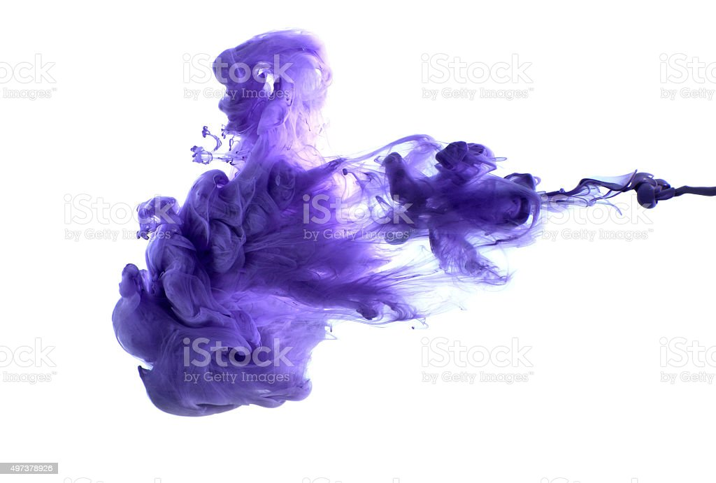 Purple acrylic paint in water. stock photo
