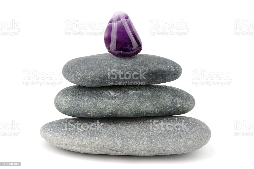 Purple Amethyst Gemstone On Piled Black Stones royalty-free stock photo