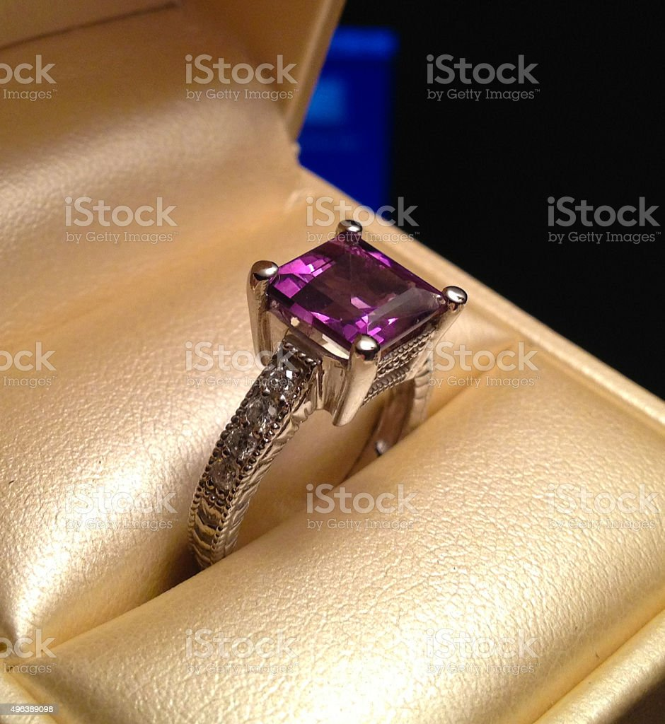Purple Amethyst Ring in Gold Case - Stock Image stock photo