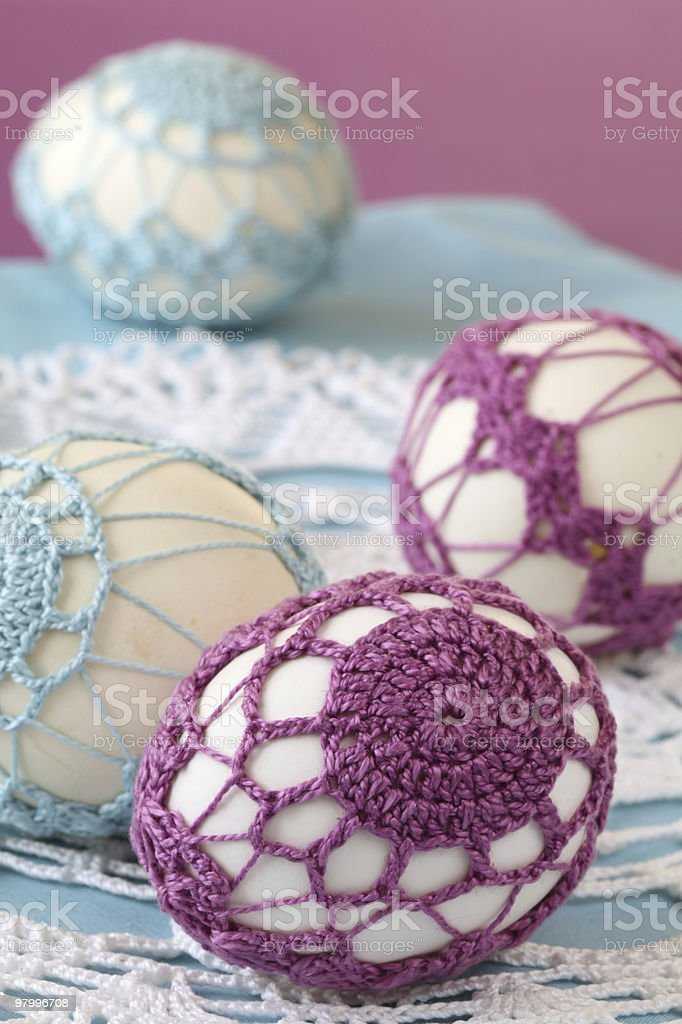 Purple and blue crochet Easter eggs royalty-free stock photo