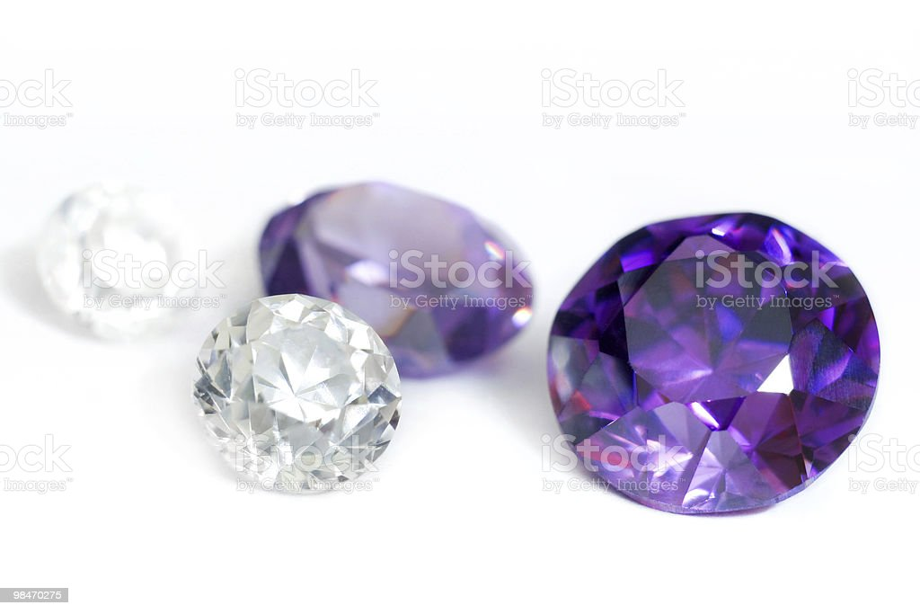 Purple and colorless gemstones close-up stock photo