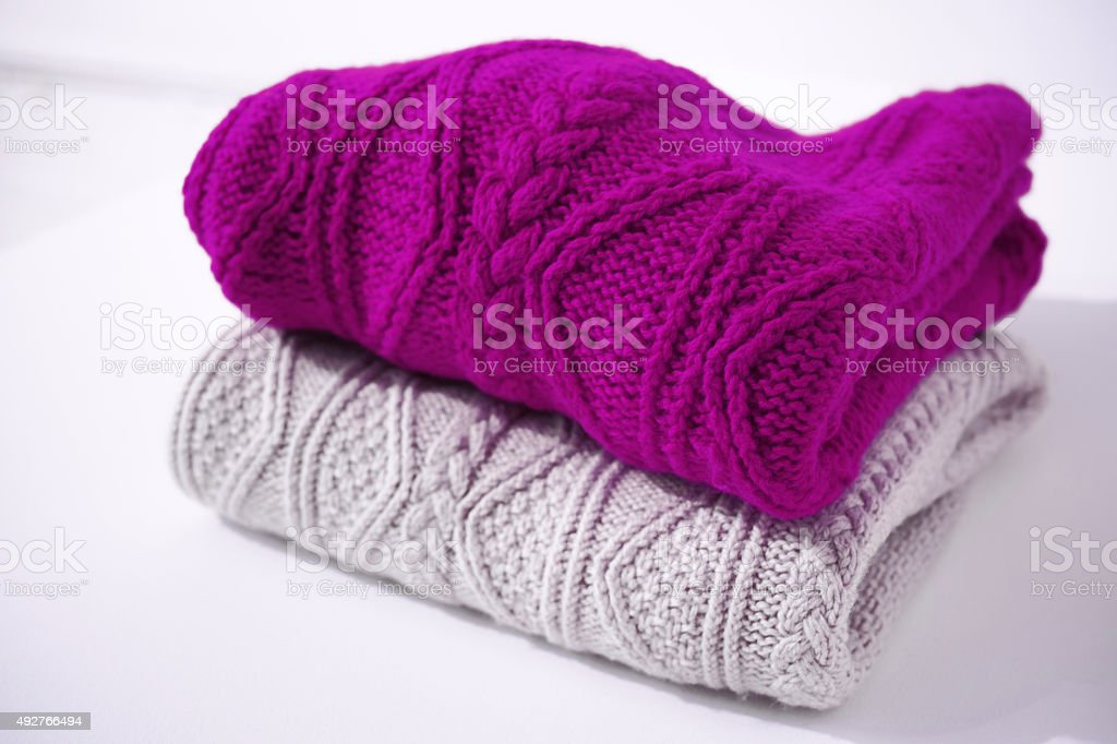 Purple And Light Brown Sweaters Isolated On White stock photo