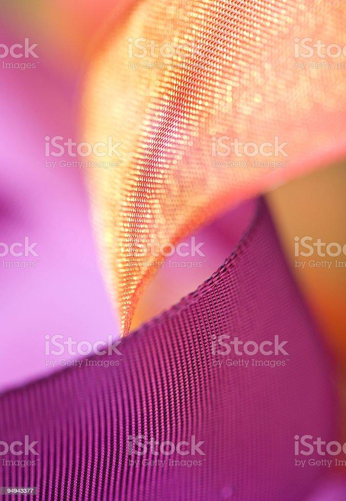 purple and orange ribbon bow curls close up royalty-free stock photo