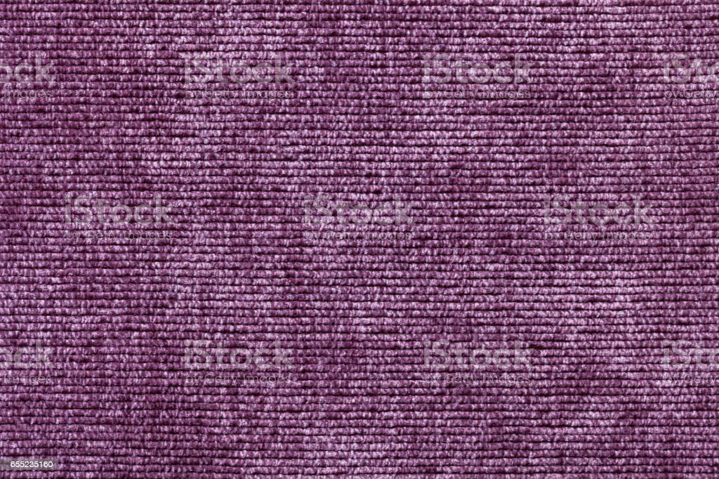 Purple background from soft textile material. Fabric with natural texture. stock photo