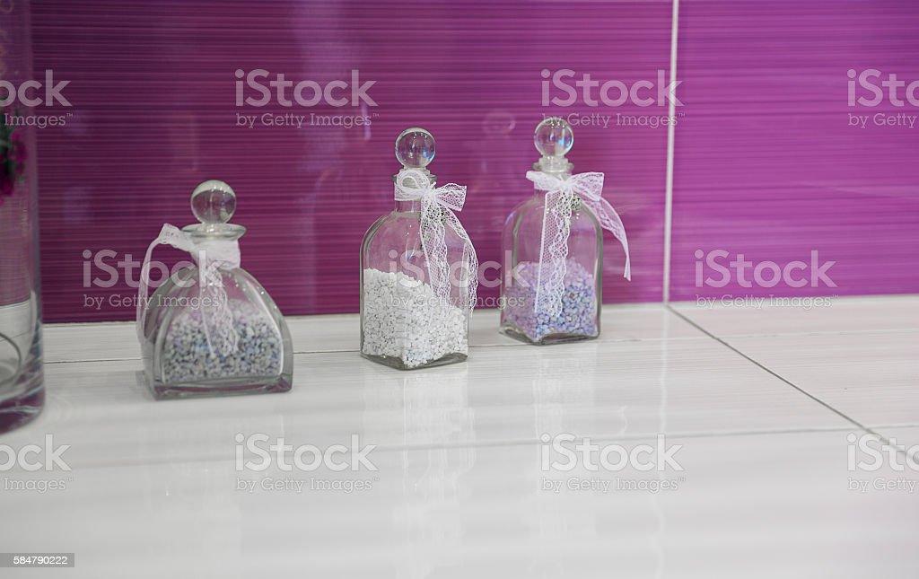 Purple bathroom with jars of bath salt stock photo