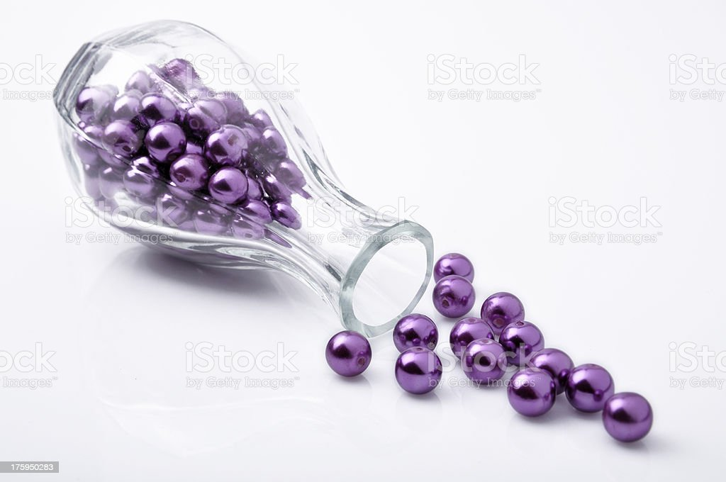 Purple beadl in the glass bottle royalty-free stock photo