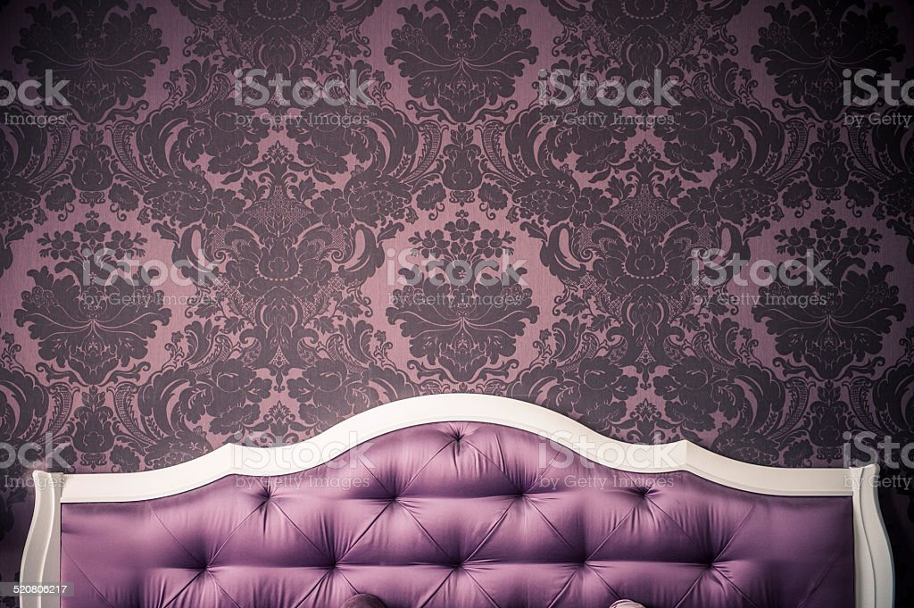 purple bedroom interior,  luxurious bed. stock photo