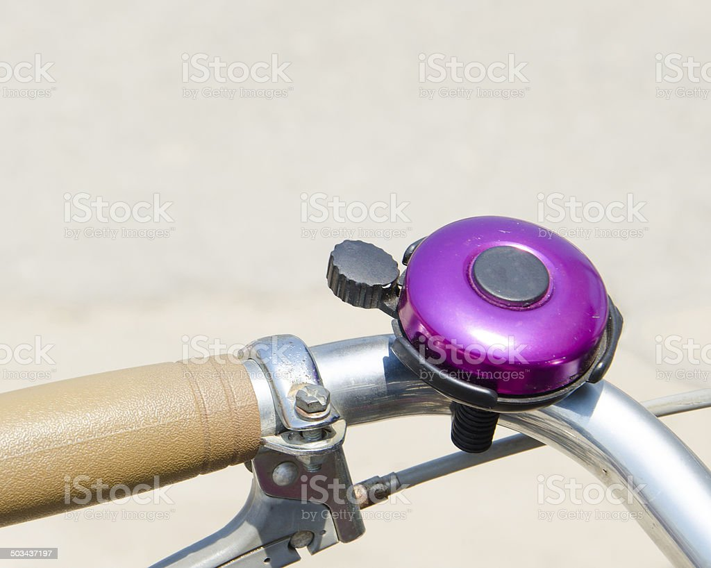 Purple bicycle bell stock photo