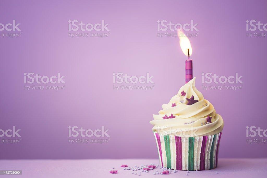 Purple birthday cupcake stock photo