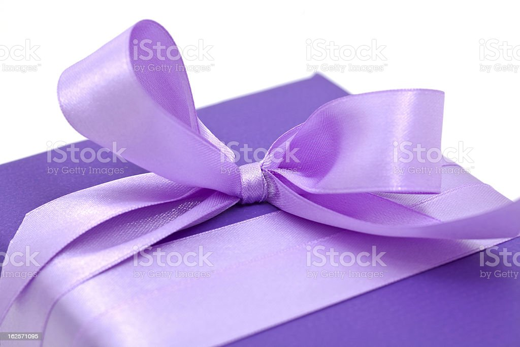 purple bow on gift box royalty-free stock photo