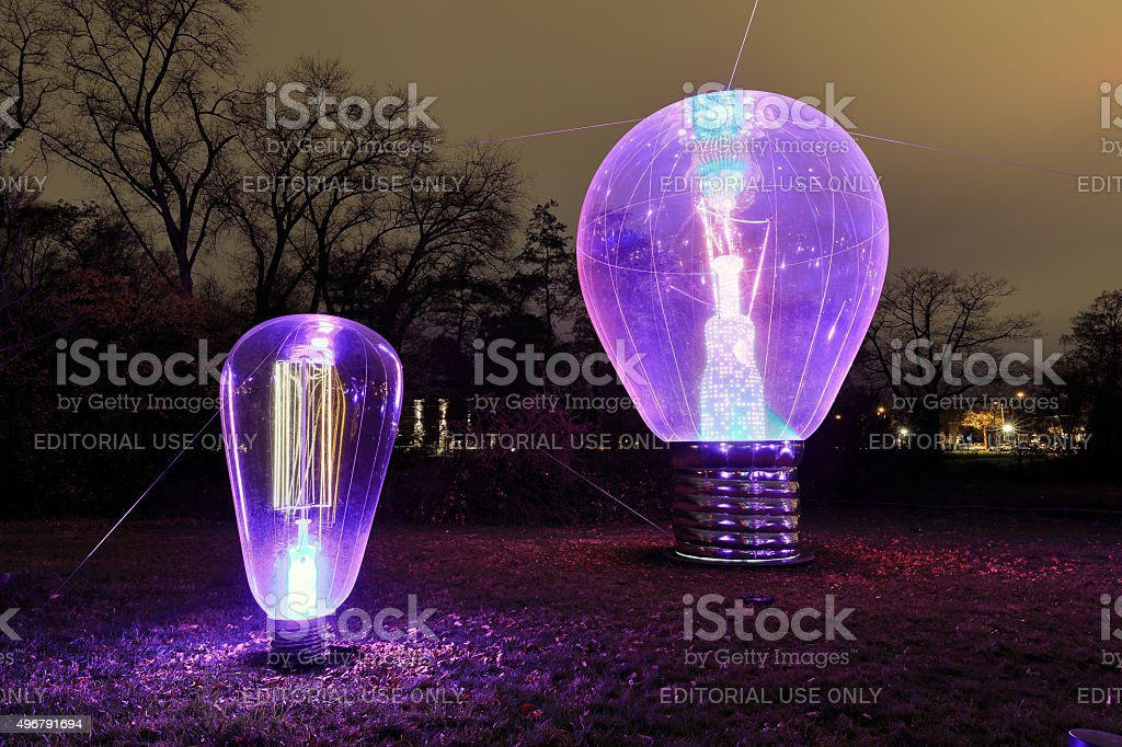 GLOW purple bulb stock photo