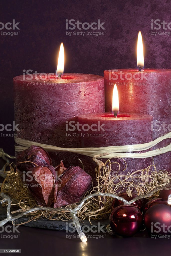 Purple candles for christmas stock photo