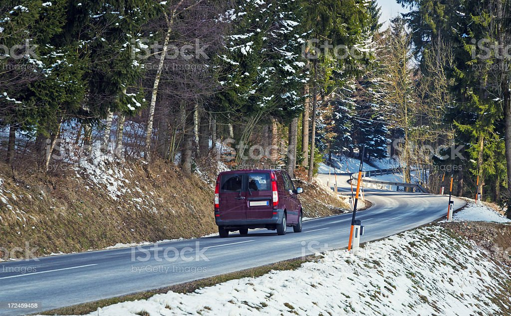 Purple car driving along a mountain pass stock photo