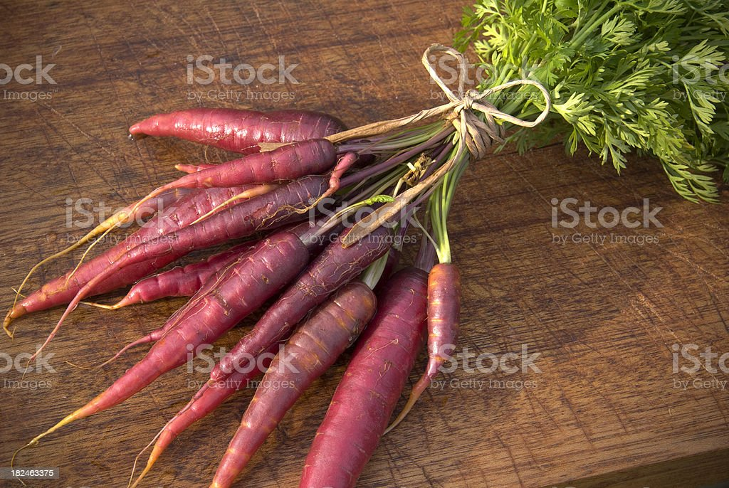Purple Carrots Root Vegetable Preparation, Fresh Organic Homegrown Produce stock photo