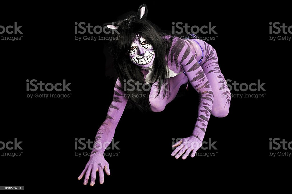 Purple Cheshire Cat on black. royalty-free stock photo