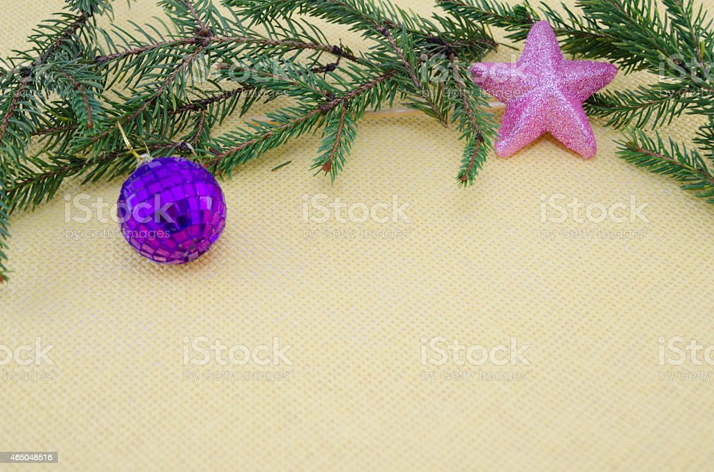 Purple Chirstmas ornament,pink star and a pine branch royalty-free stock photo