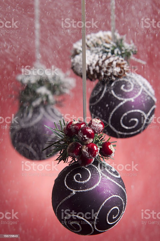 purple christmas decorating balls in snow blizzard stock photo