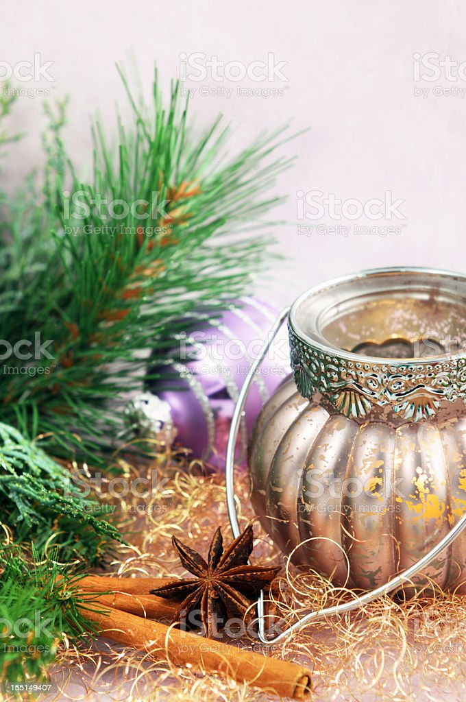 purple Christmas ornament and tea light royalty-free stock photo