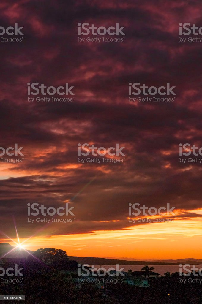 Purple clouds with flare stock photo