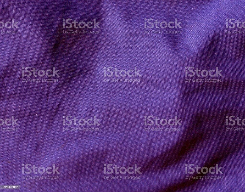purple color textile cloth surface. stock photo