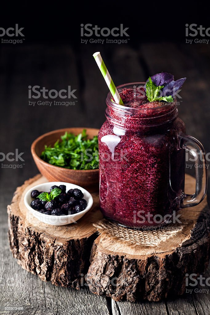 Purple detox smoothie with blackberry and basil stock photo