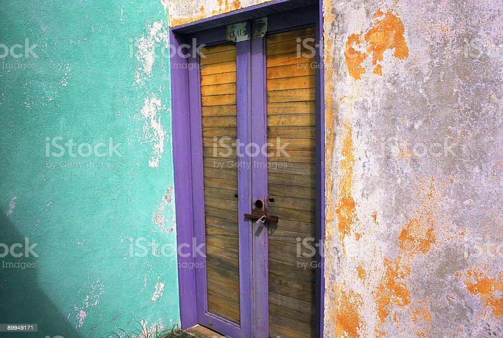 Purple Door and Weathered Wall, Mexico stock photo