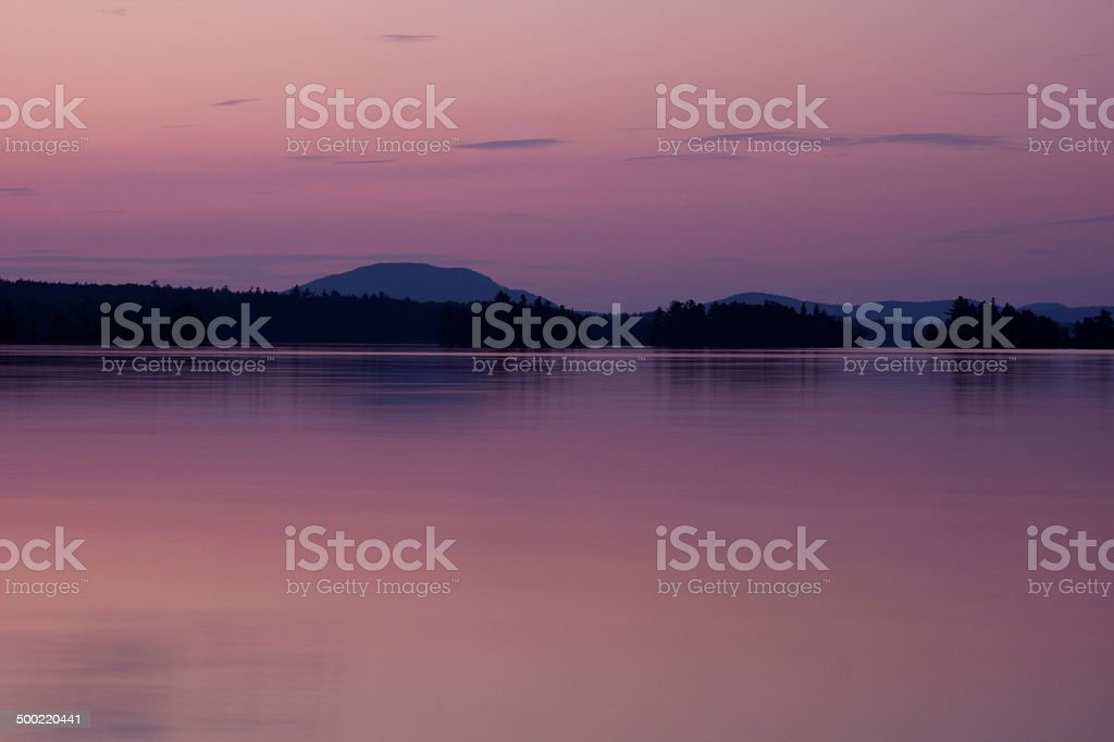 Purple evening sky over the Moosehead Lake stock photo