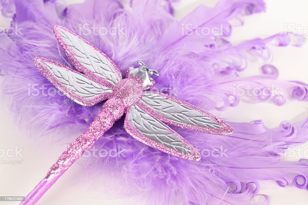 Purple Feather Fan with sparkly Dragonfly royalty-free stock photo