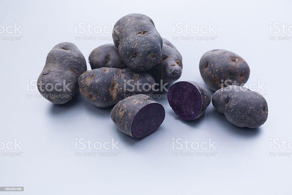 Purple fingerling potatoes stock photo