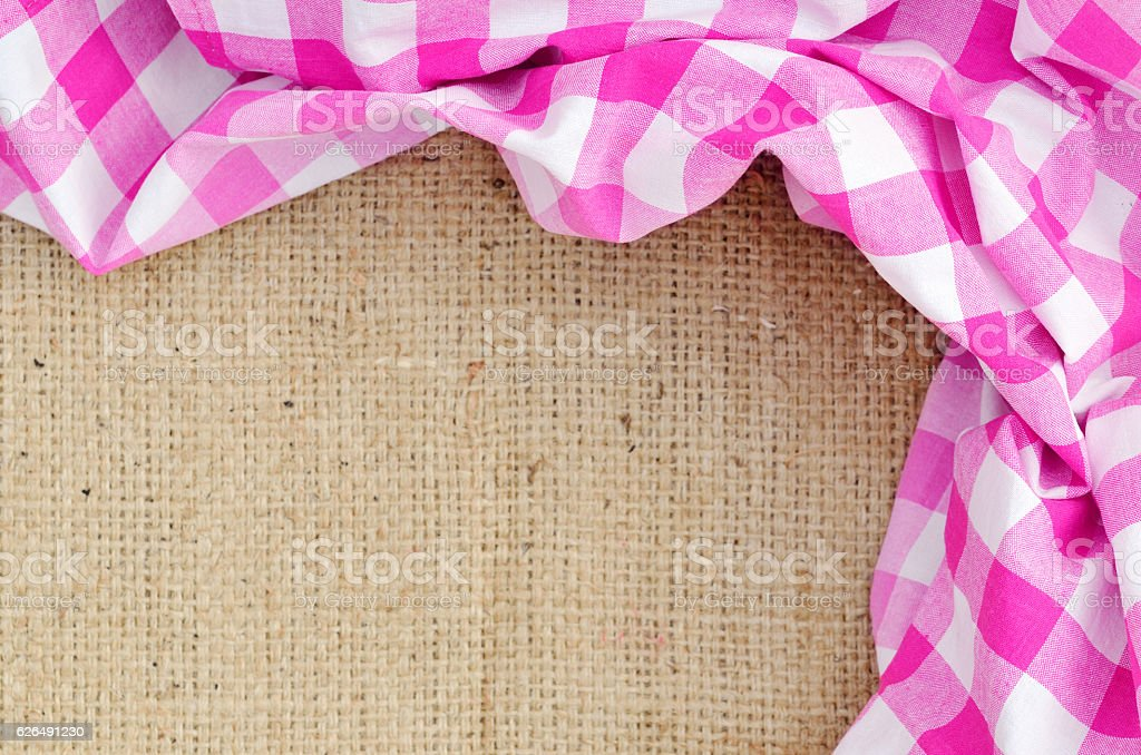 Purple folded checkered rural tablecloth over canvas - frame stock photo