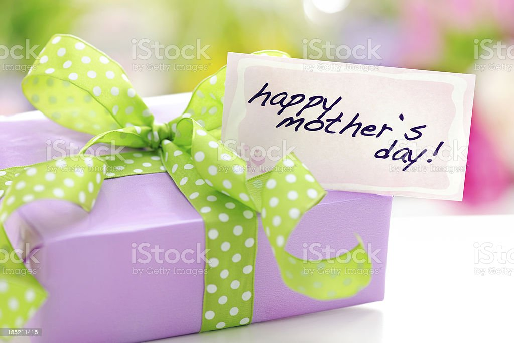 Purple gift box with a mothers day card royalty-free stock photo