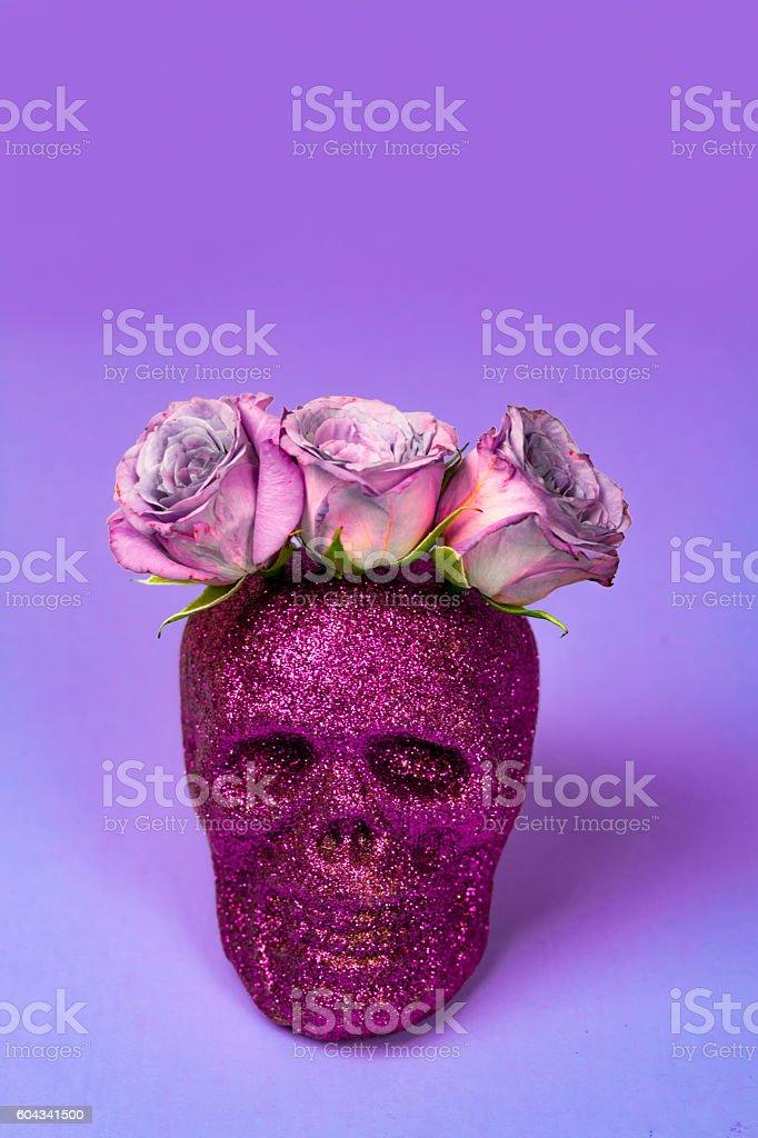 Purple Glitter Skull with Purple Rose Headpiece stock photo