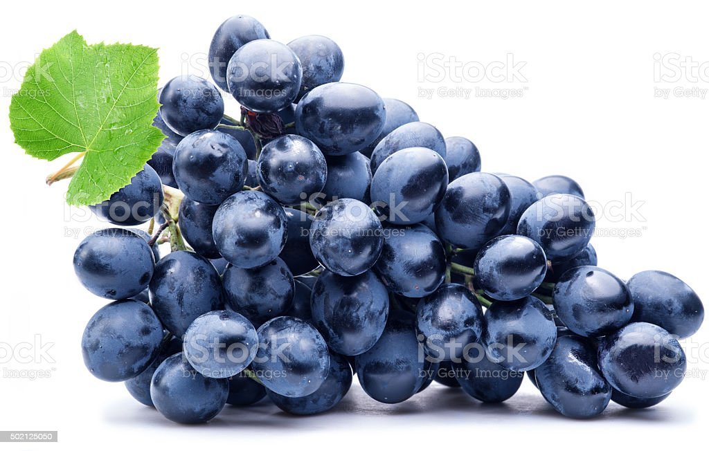 Purple grape with green leaf. stock photo