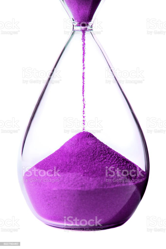 Purple hourglass on white background. stock photo