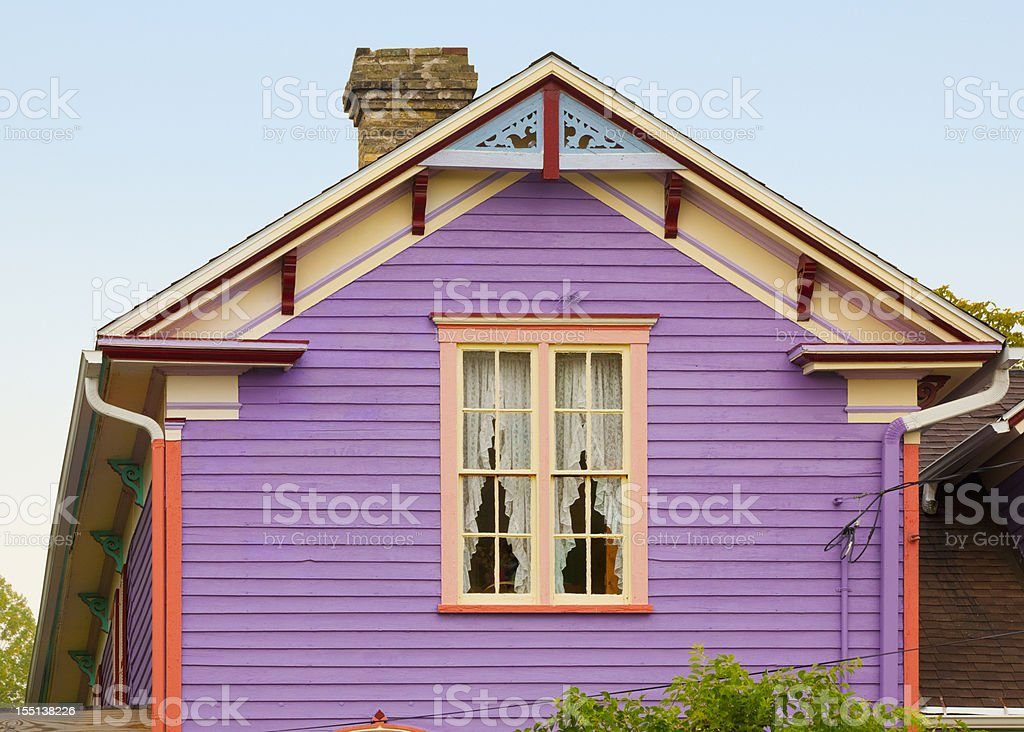 Purple House With Creative Colorful Paint Job stock photo