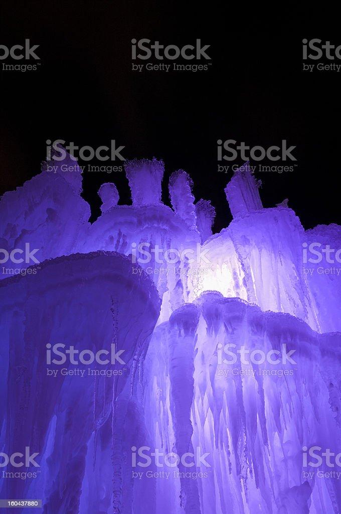 Purple Illuminated Ice Tower at Night royalty-free stock photo