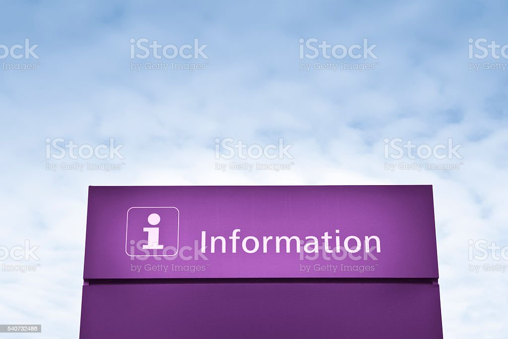 Purple information sign against a blue sky stock photo