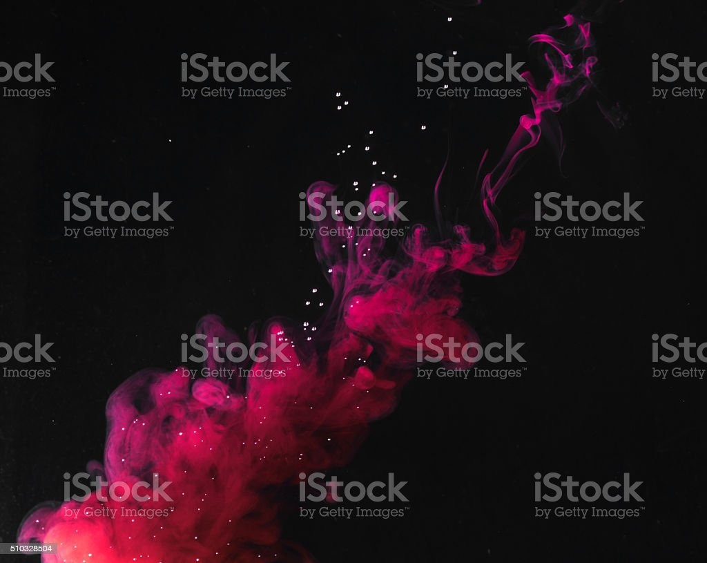 Purple ink in water stock photo