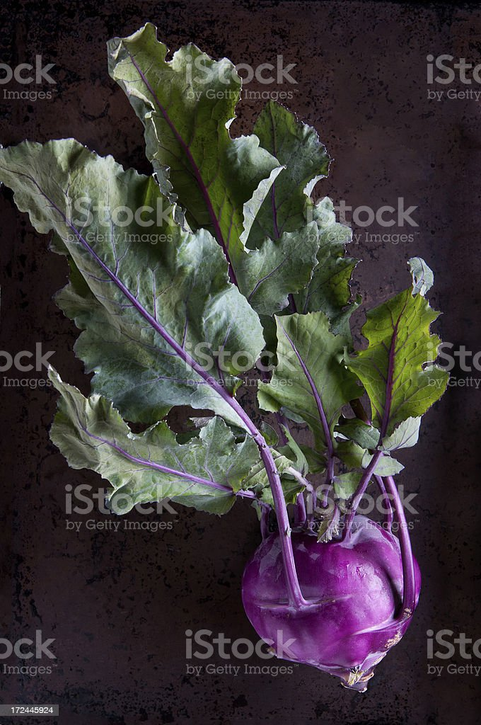 Purple Kohlrabi on a Rustic Background stock photo