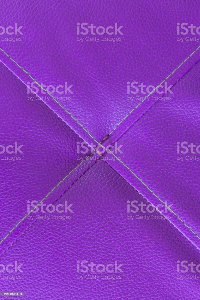 Purple leather with stitch texture and crosswise  symbol stock photo